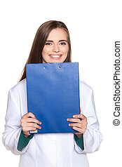 Young female student doctor with a tablet on a white background
