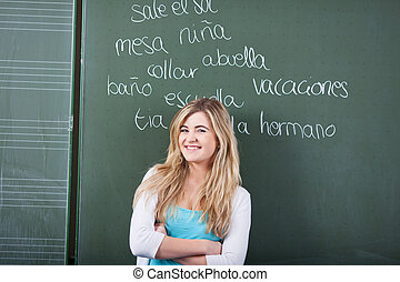 Young female student in a language class - Attractive young ...