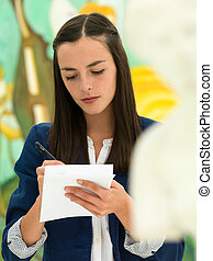 young female student in an art gallery - close-up of young...
