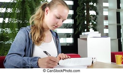 Young Female Student Studying Hard
