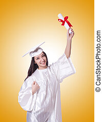Young female student with diploma against the gradient