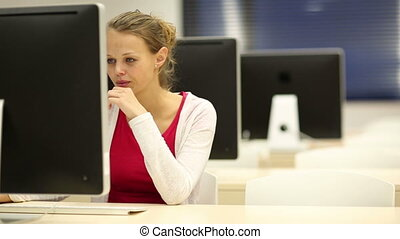 Young female student working alone