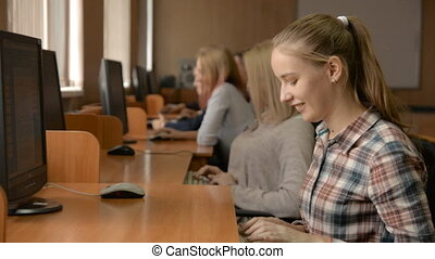 Young female student working on computer