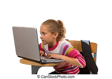 Young female student working on laptop computer
