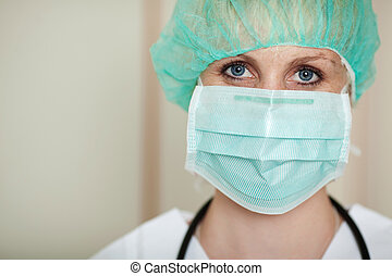 Young Female Surgeon Wearing Mask