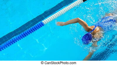 Young female swimmer swimming inside pool 4k