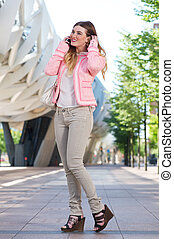 Young female talking on cellphone outdoors