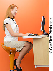 Young female teller at working place