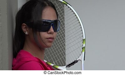 Young Female Tennis Player Wearing Sunglasses