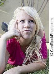 young female thinking hard