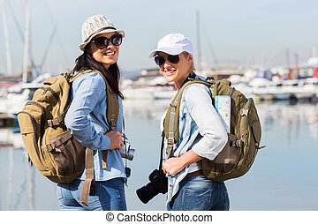 young female tourists at the harbour