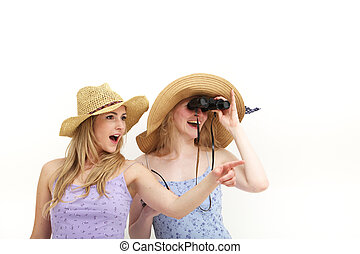 Young female tourists with binocluars