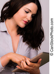 Young female using ipad tablet