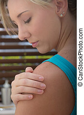 Young Female with a shoulder pain