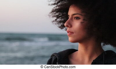 Young female with afro hairstyle look at the camera