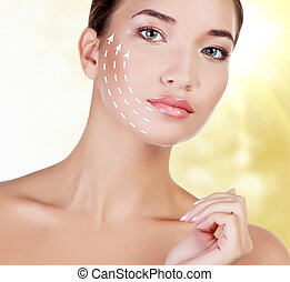 Young female with clean fresh skin, abstract background with blu