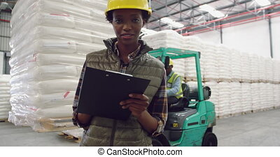 Young female worker in a warehouse
