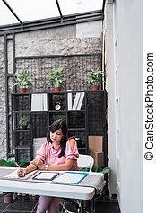 female worker in her office working on paperwork