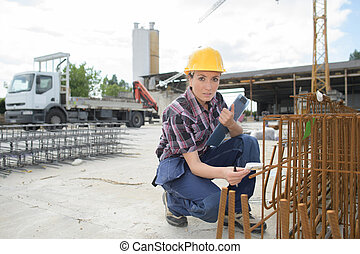 young female worker in the construction site