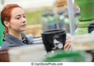 young female worker in warehouse