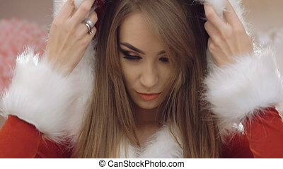 Young festive woman looking at camera. Slowly