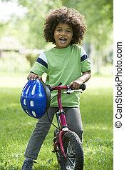 young fiú, tanulás, to elnyomott, bicikli, dísztér