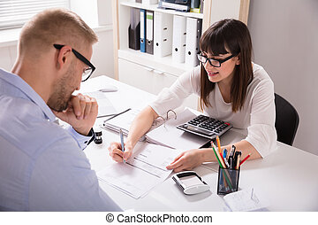 Financial Advisor Discussing Invoice With Her Client