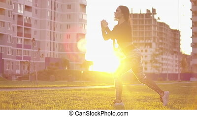 young fit and energetic woman doing sport workout and ...