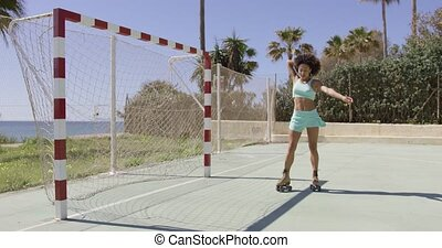Young fit girl in roller skates - Young pretty fit woman in...