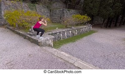 Fit Woman Doing Cardio Exercises In The Park