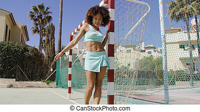 Young fit woman on playground