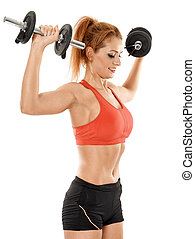 Young fit woman working out with dumbbells