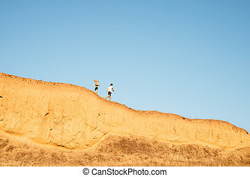 Young fitness couple jogging on a hill