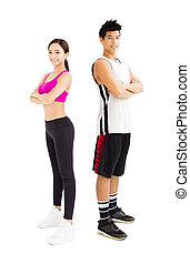 young fitness couple standing together isolated on  white