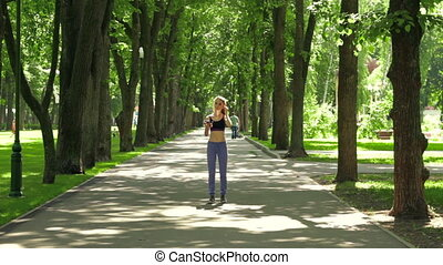 young fitness girl in pants runs through the Park in the...