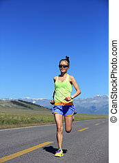 young fitness healthy lifestyle woman runner running on road