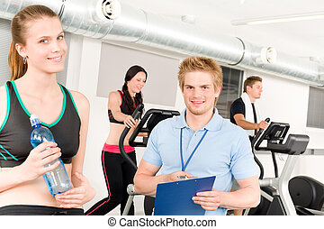 Young fitness instructor gym people exercise