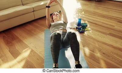 Young fitness woman doing exercise at home. - Beautiful...