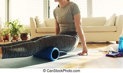 Young fitness woman doing exercise at home. - Unrecognizable...