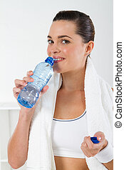 young fitness woman drinking