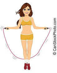 young fitness woman jumping rope