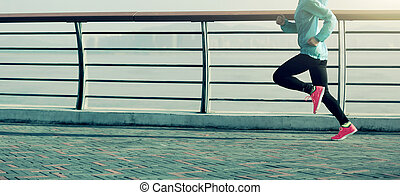 young fitness woman on seaside