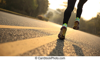 young fitness woman runner athlete legs running at road