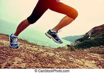 young fitness woman runner legs run
