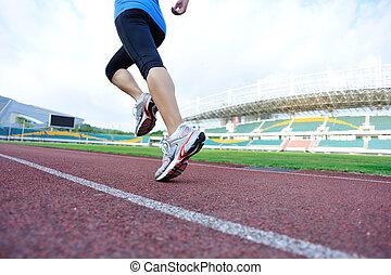 young fitness woman runner legs run