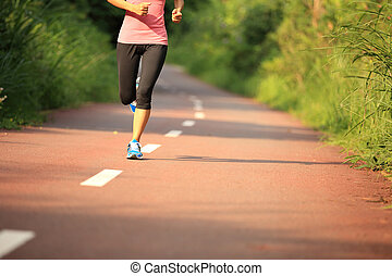 young fitness woman runner legs