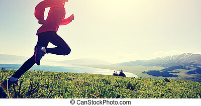 young fitness woman runner running on mountain peak