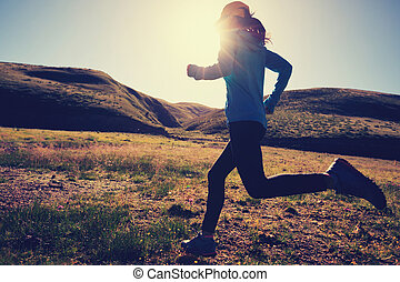 young fitness woman runner running outdoors