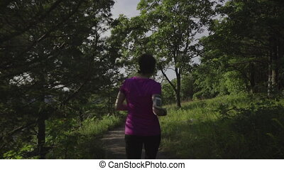 fitness woman running at forest trail - young fitness woman...