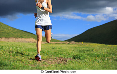 young fitness woman trail runner running outside